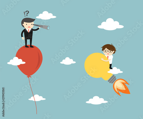 Business concept, Businessman use telescope seeing another businessman on the light bulb Wallpaper Mural