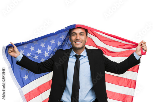 Caucasian businessman holding America flag.. Wallpaper Mural