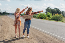 Two Beautiful Girls Hitchhikin...