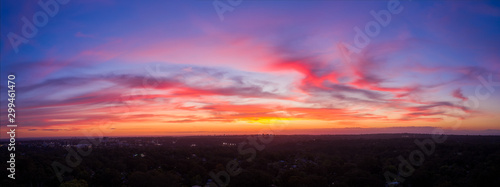Cuadros en Lienzo Colourful cloudscape aerial sunset panorama of Sydney Western suburbs