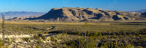 A car travels Scenic Loop Drive in Red Rock Canyon National Conservation Area in Wallpaper Mural