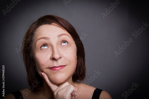 Woman grimaces in front of camera Canvas-taulu
