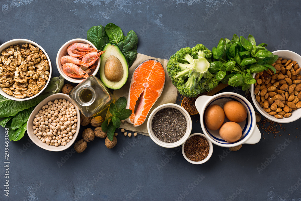 Fototapeta Health food fitness. Food sources of omega 3 on dark background top view. Foods high in fatty acids including vegetables, seafood, nut and seeds