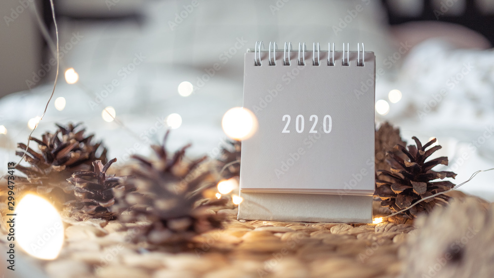 Fototapety, obrazy: New Year 2020 calendar with lights on rustic server with cones and toys
