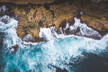 Views Of Waves Tossing Around Rocks In The Ocean