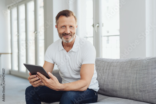 Casual middle-aged man relaxing at home Canvas-taulu