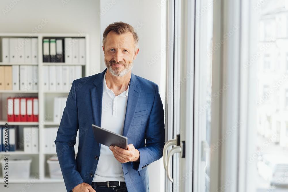 Fototapeta Smart relaxed confident senior businessman