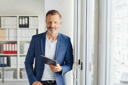 Smart relaxed confident senior businessman