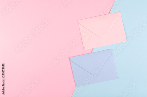Blue paper envelope composition on pink background. Wallpaper Mural