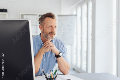 Thoughtful businessman staring through a window