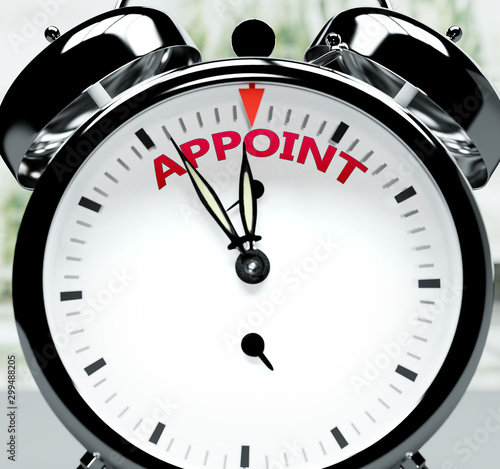 Photo Appoint soon, almost there, in short time - a clock symbolizes a reminder that A