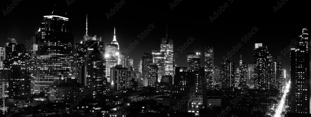 Fototapeta Panoramic night view of Midtown Manhattan and Hell's Kitchen, black and white