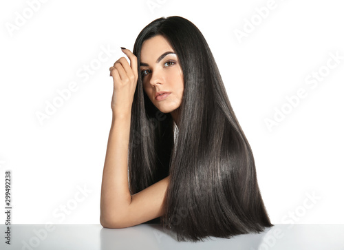 Vászonkép Portrait of beautiful young woman with healthy long hair on white background