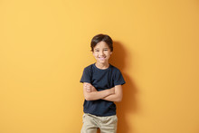 Cute Little Boy On Color Backg...