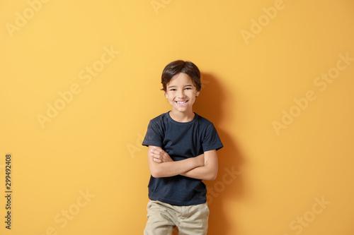 Obraz Cute little boy on color background - fototapety do salonu