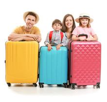 Happy Family With Suitcases Is...