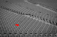 Football Stadium With Empty Seats. Outstanding Empty Red Plastic Chair At Soccer Arena. Row Of Unoccupied Bench At Sports Stadium. Reserved Seating For Football Game Concept. Outdoor Audience Chairs.