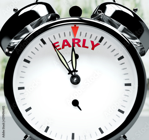Vászonkép Early soon, almost there, in short time - a clock symbolizes a reminder that Ear