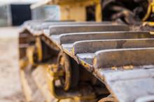 Yellow Tractor On Crawler Trac...
