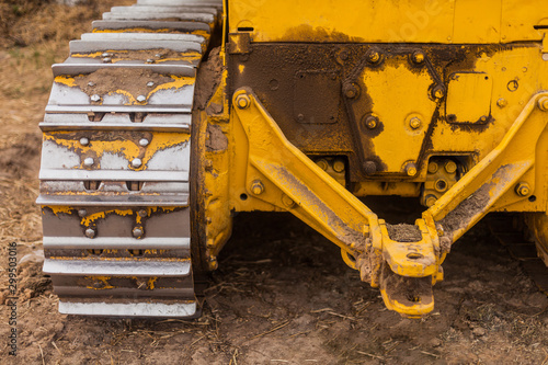 Fotomural  Yellow Tractor on crawler track