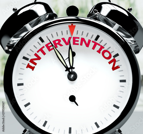 Obraz na plátně Intervention soon, almost there, in short time - a clock symbolizes a reminder t