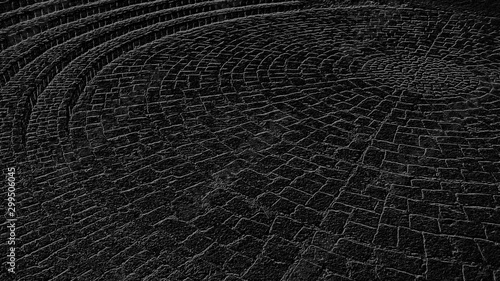 Fotografía  Black and gray background, reminiscent of a cobblestone street in the old town