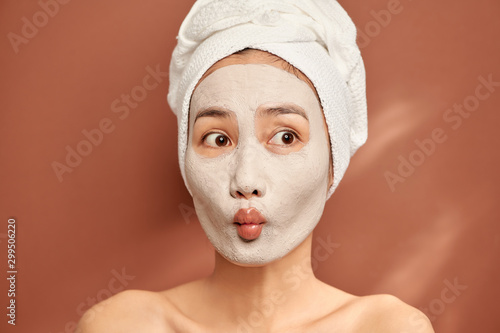 Fotografie, Obraz  Young Asian woman enjoying of a facial mask treatment.