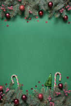 Christmas Tree Branches, Red Glass Balls On Green With Copy Space. Top View. Holiday Card.