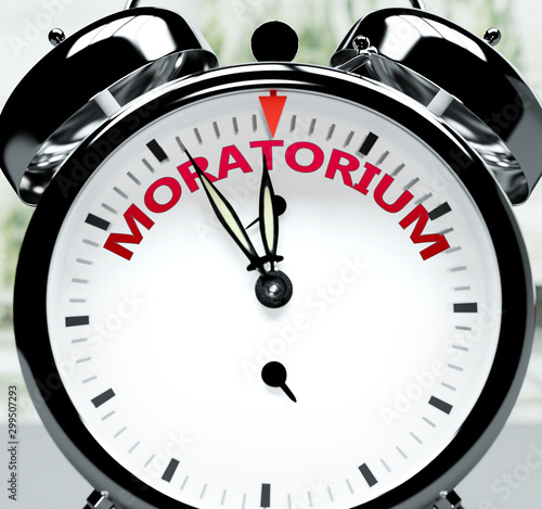 Vászonkép Moratorium soon, almost there, in short time - a clock symbolizes a reminder tha