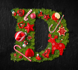 Letter D made of Christmas tree ornaments