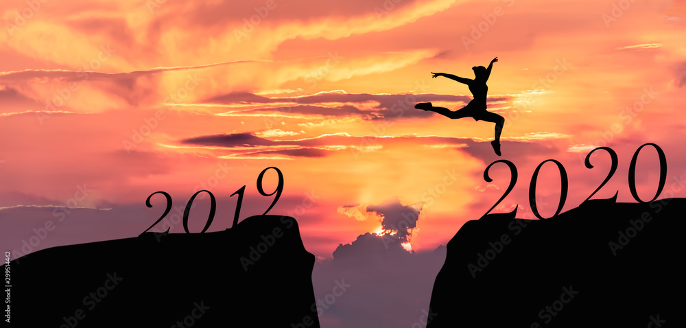 Fototapety, obrazy: Happy new year 2020, Silhouette of 2020 letters on the mountain with business people jump across gap of mountain at sunrise.