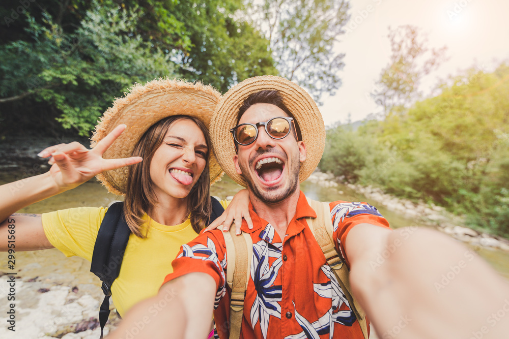 Fototapeta Couple travel and take a selfie on vacation