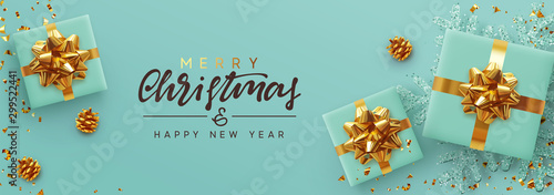 Christmas banner. Background Xmas design of realistic gifts box, blue snowflake and glitter gold confetti. Horizontal poster, greeting card, headers, website. Decoration objects flat lay, top view - 299522441