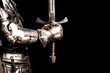 canvas print picture - cropped view of knight in armor holding sword isolated on black