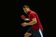 Young Man Plays Table Tennis On Black Studio Background. Model In Sportwear Plays Ping Pong. Concept Of Leisure Activity, Sport, Human Emotions In Gameplay, Healthy Lifestyle, Motion, Action, Movement