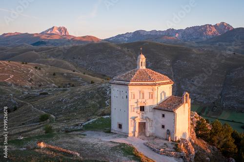 Foto auf Gartenposter Himmelblau Beautiful chapel Chiesa di Santa Maria della Pietà at sunrise with barren landscape and mountain of Corno Grande in background, Rocca Calascio, Abruzzo, Italy