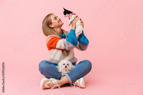 Cute lovely girl wearing sweater sitting with legs crossed