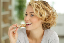 Beautiful Woman Eating A Cerea...