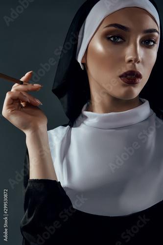 Close-up portrait of a nun, taking on a black background Tapéta, Fotótapéta