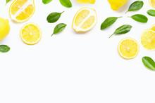 Fresh Lemon With Green Leaves On White.