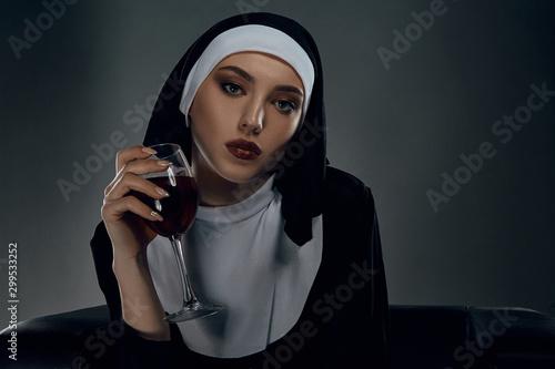 Valokuva Portrait shot of a nun, taking on a black background