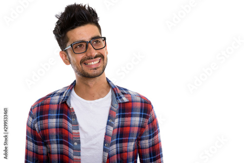 Fototapeta  Portrait of young bearded Persian hipster man with eyeglasses