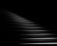 Black Background. Stone Stairs With Abstract Light. Steps In The Darkness. 3D Rendering