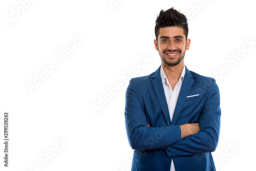 Obraz na plátne Young handsome bearded Persian businessman in suit