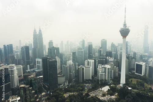 View from above, stunning aerial view of Kuala Lumpur skyline with the magnificent KL Tower and other skyscrapers during a foggy day Wallpaper Mural