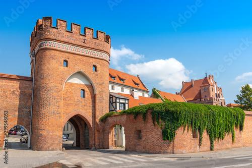 Fotomural Bridge Gate (Polish: Brama Mostowa) from 1432 and city wall in Torun, Poland