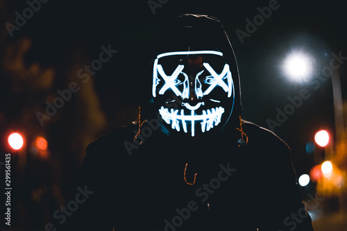 Stampa su Tela Blue LED halloween mask with a street background.
