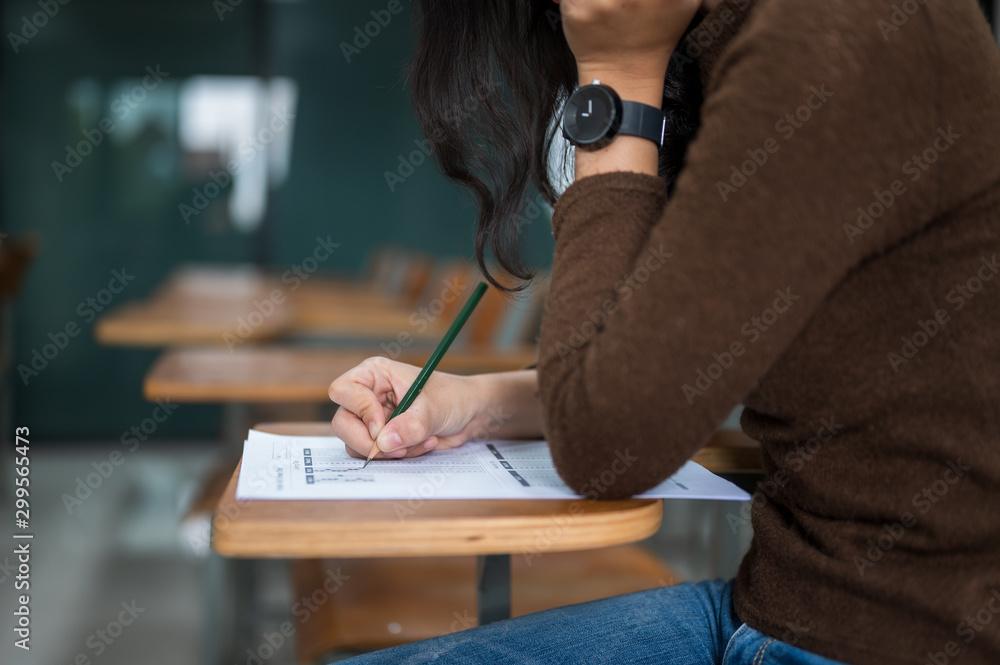 Fototapety, obrazy: Female students taking tests at the university