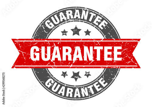 Fotografía  guarantee round stamp with red ribbon. guarantee