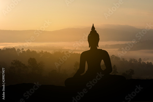 Poster Temple Silhouette Buddha on golden sunset background.
